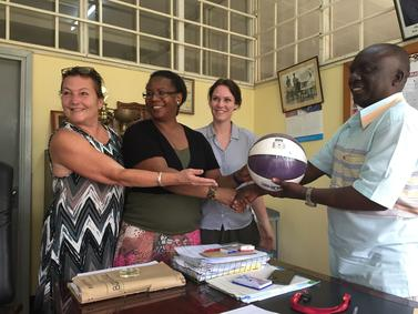 Wendy L. Meyer, Prisca Bruno Massao, and Guro Hagen of INN University, exchange gifts with MTC Principal Dr Colonel Chambulila. (Photo: Guro Hagen)